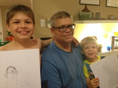 My two kids proudly showing off sketches of their encouraging dad, who sat still so they could observe him, and refrained from all judgment.